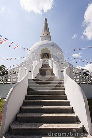Stupa -   mound-like or semi-hemispherical structure containing Buddhist relics, used by Buddhists as a place of meditation.