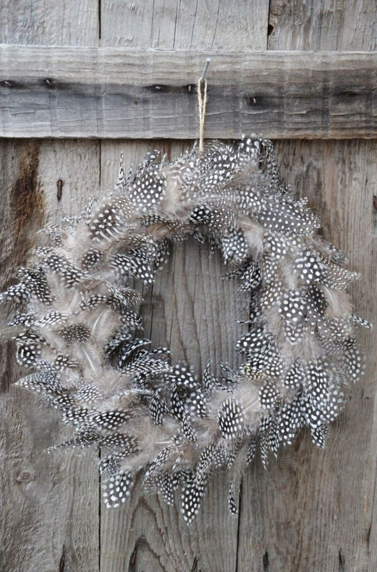 A wreath if feathers for Easter decoration and styling.