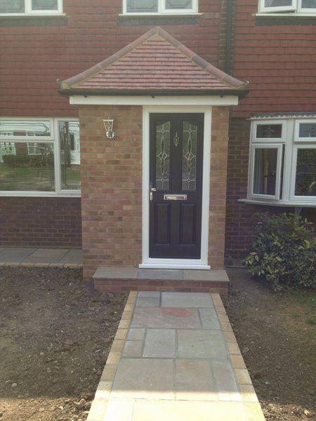Front porch, black door, white uPVC windows https://upvcfabricatorsindelhi.wordpress.com/