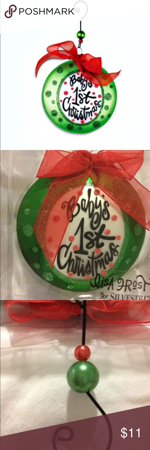 Lisa Frost Baby's 1st Xmas hand-painted ornament BRAND NEW in BRAND NEW BOX! GIFT GIVING READY!  Hand-painted glass ornament 4 baby's 1st tree from Lisa Frost collection. Unusual & attention getting disc shape, the design & artwork has Frost's signature style. Glitter accents, deep holiday green circular motif w/white center w/Baby's 1st Christmas whimsically written in blk w/red dot glitter accents! Adorable!  Even hook unusual w/red & green bead accent &clever shape. Tied festively w/red…