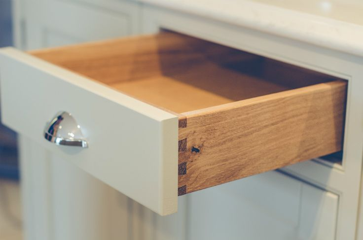 Solid oak dovetailed drawers in an inframe kitchen at Newhaven Kitchens.