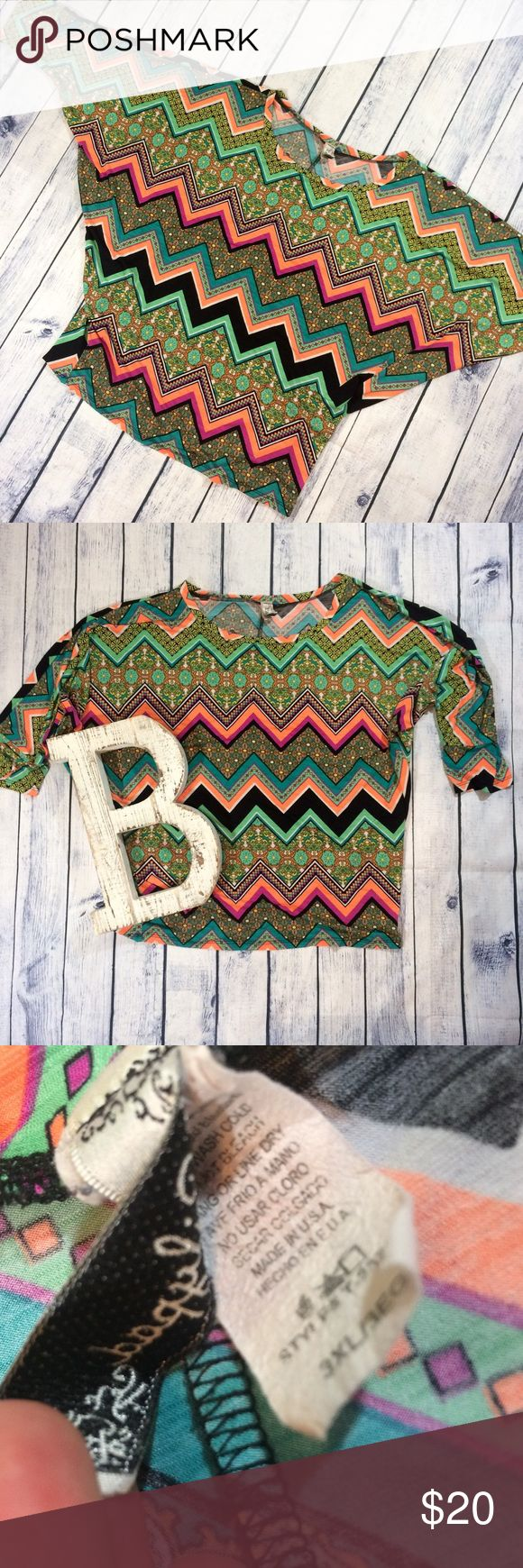 Plus size chevron fun dolman style top size 3x Great used condition! Pretty and fun colors in a details chevron print! Dolman style sleeves. Scoopneck. Band at hem. Size 3x. Make me an offer! 20% off all bundles! boutique Tops