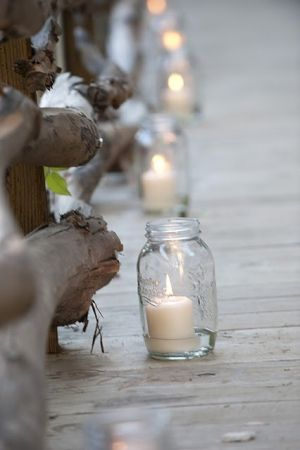 Mason jars with candles to light a path or baby food jars with pink ribbon and rafia.