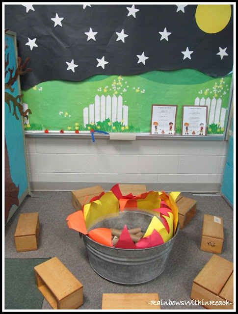 Make a camping themed reading area out of construction paper, a bucket, and toilet paper rolls.