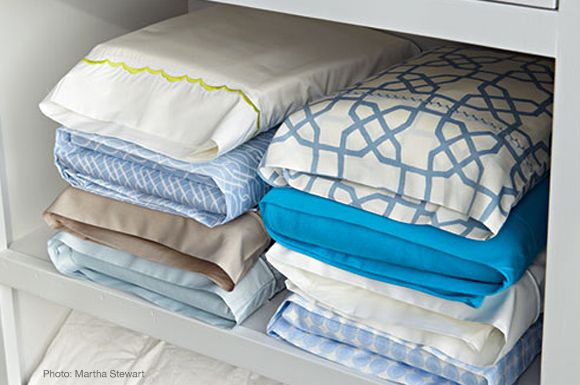 Fold sheets and store inside pillowcase.  We do this and it makes them so easy to keep together.