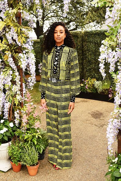 Corinne Bailey Ray in a bright yellow and black patterned jumpsuit at the Barclaycard presents the British Summer Time 2016 Media Day on June 29, 2016.