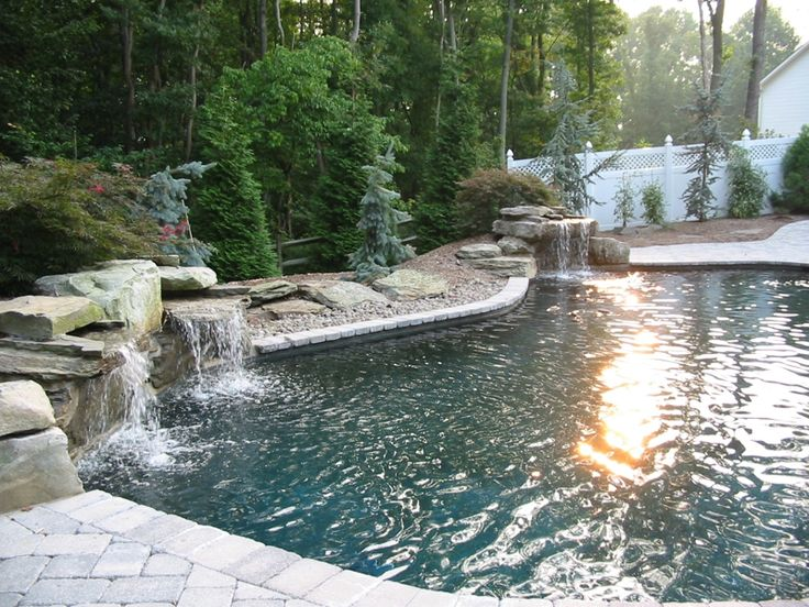 in ground gunite swimming pool with waterfalls