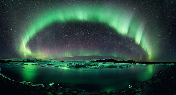 "A dazzling green aurora frames the arc of the Milky Way over Jökulsárlón, the largest glacier lake in Iceland, on March 10. The picture is a first-prize winner in the Second International Earth and Sky Photo Contest's ""Beauty of the Night Sky"" category."