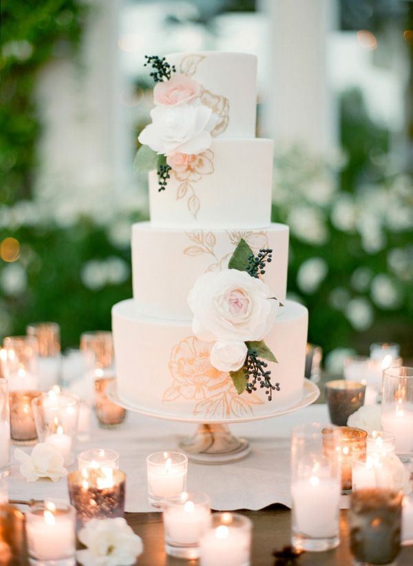 Floral Print Wedding Cake Surrounded by Candles