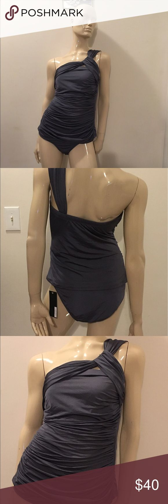 Size XL 1Sol swimsuit NWT Gorgeous size XL 1Sol charcoal grey 2 piece swimsuit, bikini cut bottom, gorgeous asymmetrical tankini top with ruching, this is a breathtaking swimsuit, sure to garner plenty of compliments! NWT. 1Sol Swim