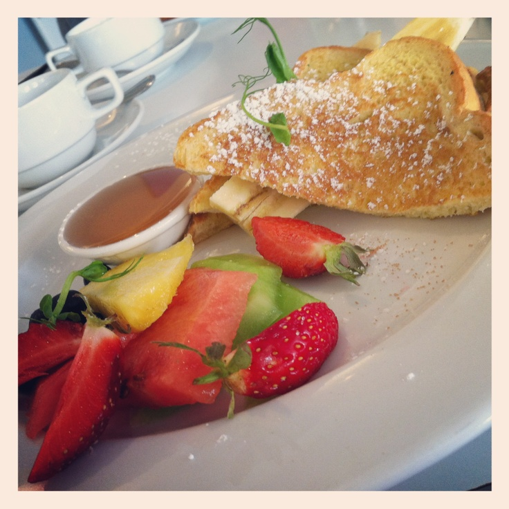 French Toast with grilled banana, maple syrup and fresh fruit - Napier, New Zealand