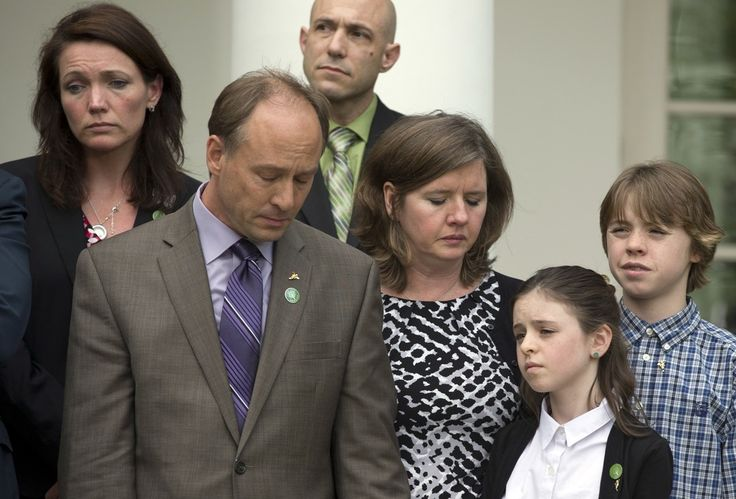 Newtown shooting family members dejected after background check bill is defeated in the US Senate (Photo: Carolyn Kaster / AP)