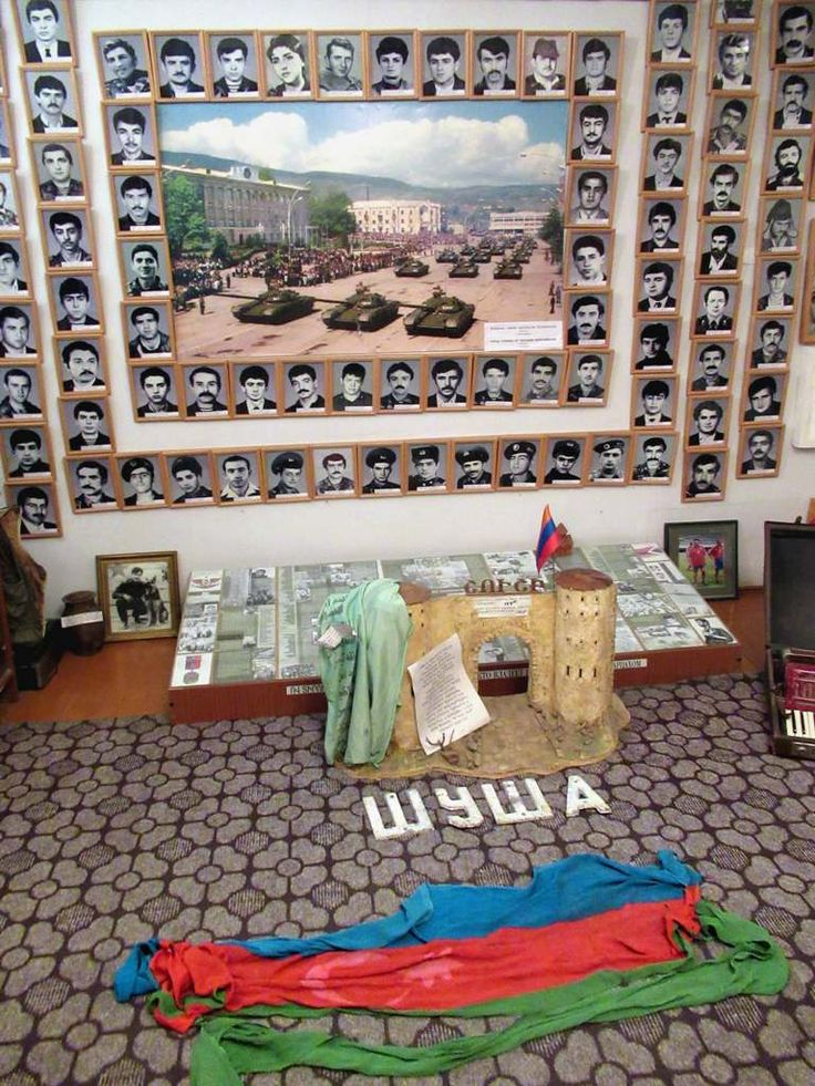 The Museum of Missing and Fallen Soldiers in Stepanakert, Republic of Nagorno Karabakh, displays photos of Armenians killed in battle snce 1988. Visitors may use the Azerbaijan flag on the floor for wiping their shoes.