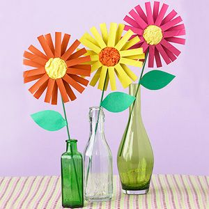 Bright Painted Flowers out of toilet tubes. Stacey this one is for you, don't you feel guilty now for throwing that gift wrap roll away!!!