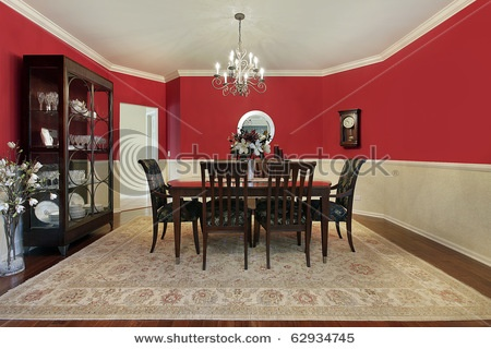 Dining Room With Red Upper Half Walls Dark Wood Set And Floor