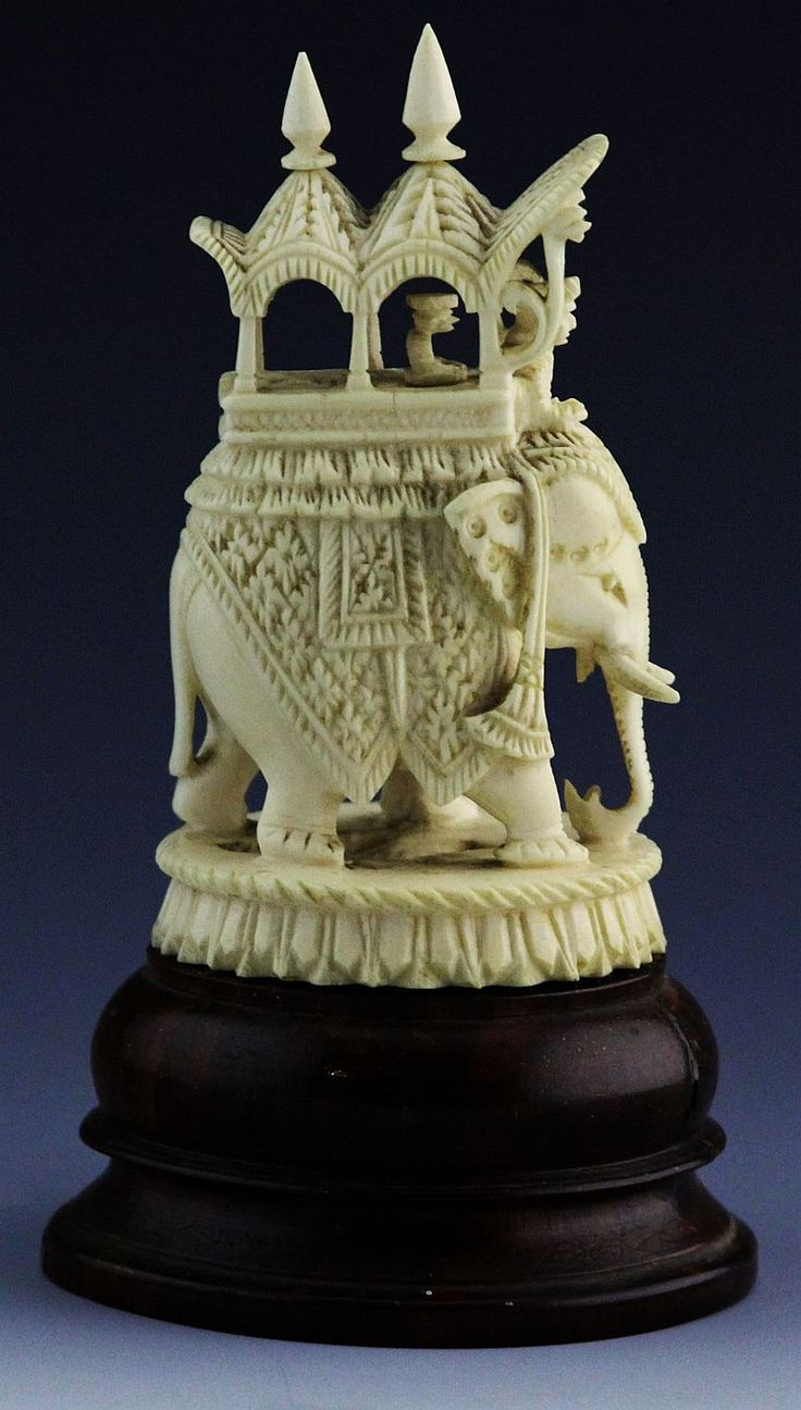 "ANTIQUE CENTURY CARVED IVORY ELEPHANT WITH HOWDAH Indian ivory carving of elephant with howdah, attached to wooden base. Weight: 228 g Size: 4.25"" plus stand"