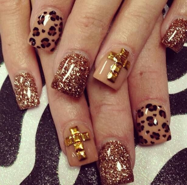 Neutrals, leopard, glitter, gold studded cross. | See more nail designs at http://www.nailsss.com/acrylic-nails-ideas/2/