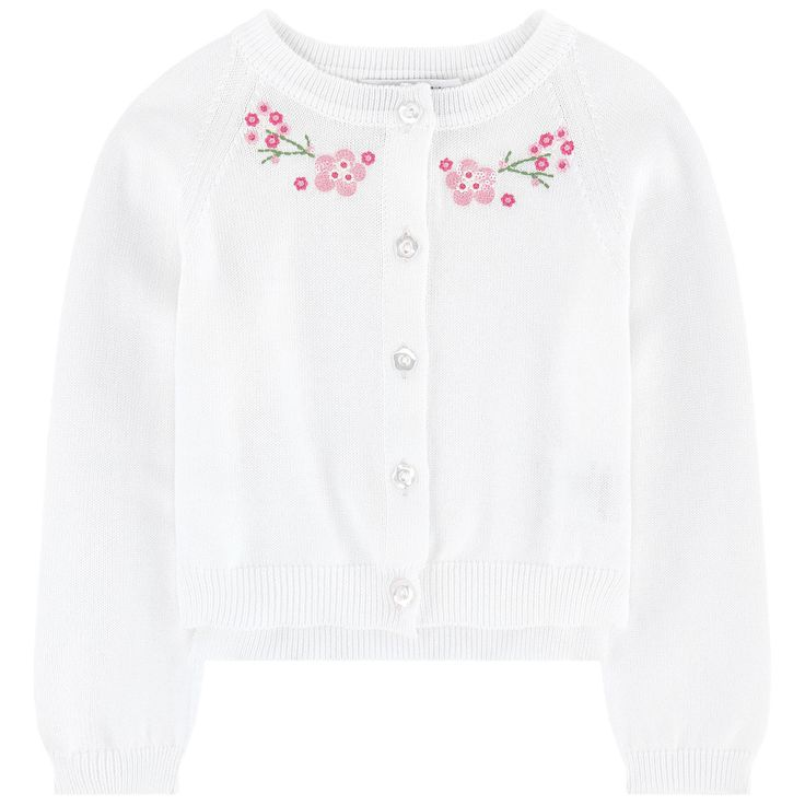 Cotton knit  Pleasant to the touch Comfortable item Crew neck Raglan long sleeves Gathered cuffs Slits at the bottom Button on the front Fancy buttons Fancy sequins Embroideries - 101,40 €