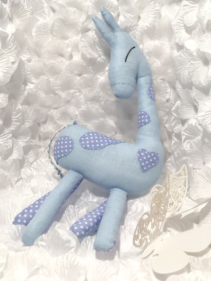 Handmade blue giraffe with cotton elements