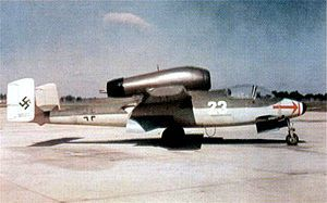 """The Heinkel He 162 Volksjäger (German, """"People's Fighter"""") was a German single-engine, jet-powered fighter aircraft fielded by the Luftwaffe in World War II. Designed and built quickly, and made primarily of wood as metals were in very short supply and prioritised for other aircraft, the He 162 was nevertheless the fastest of the first generation of Axis and Allied jets.  wem"""