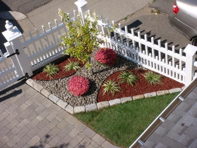 Mulch garden for shaded (grass-less) area in back yard... Instead of loose rock shown, use cobble stones for fun pathway. Perfect for covering up ugly area where grass won't grow.