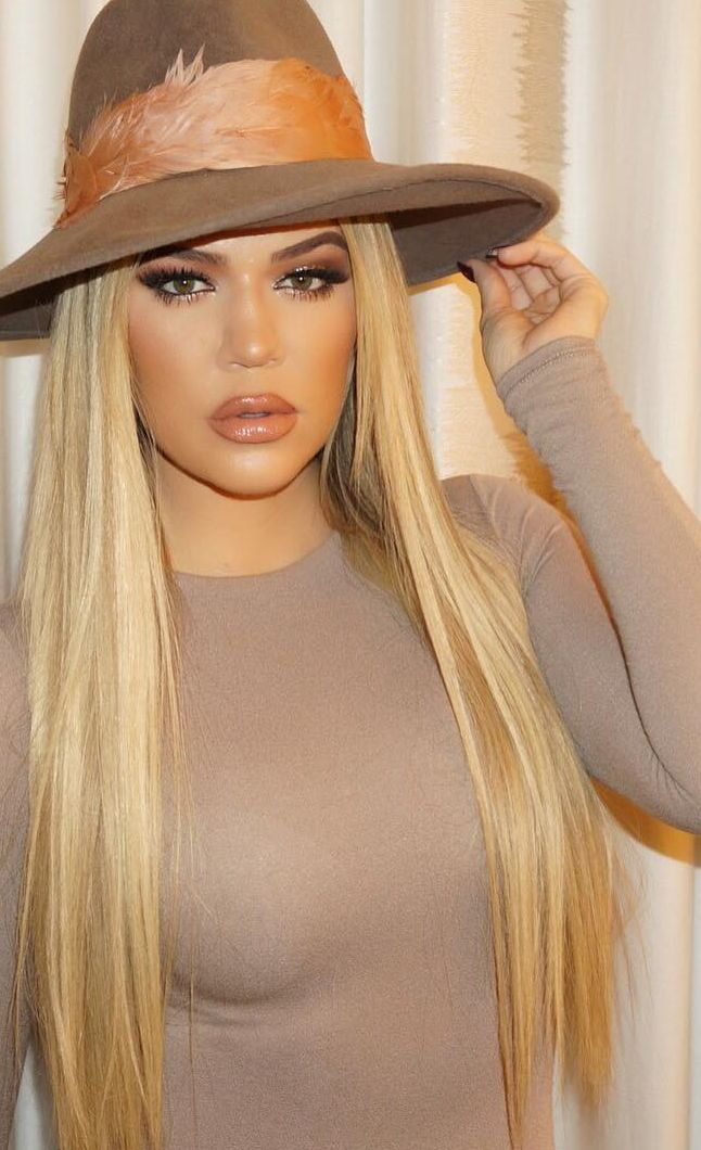 Who made  Khloe Kardashian's tan hat and beige long sleeve top?