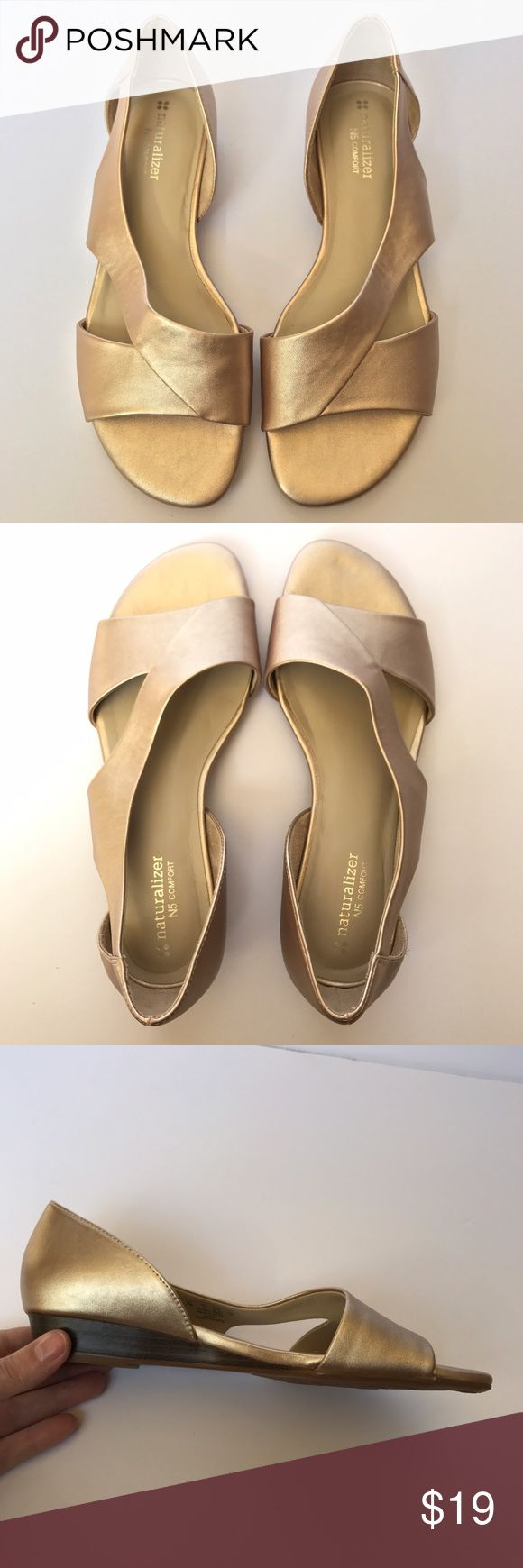 • Naturalizer • gold colored sandals Gorgeous light gold colored sandals. Metallic shoes with wide straps. Very small wedge style heel. So comfortable and stylish! Only worn once. Naturalizer Shoes Sandals