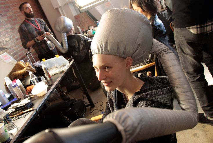 Models sit under hair dryers backstage before the Peter Som Fall 2012 collection is presented, Feb. 10, 2012. (Richard Drew/Associated Press) #