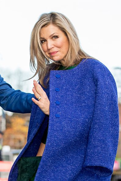 Queen Maxima of The Netherlands wrapped up in a royal blue wool Natan Coat as she visits Day of the Entrepreneur in the Netherlands in Delft