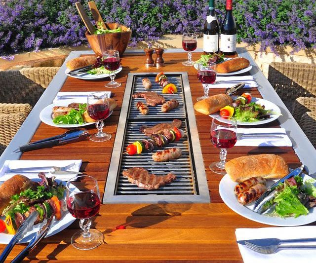 Take a new approach to outdoor cooking by gathering everyone around the 8-seater barbecue table. This gorgeous wood table comes with a built-in gas grill that runs along the center, so that every guest can have  easy access to the hot food.