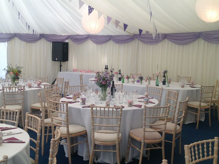beautiful lilac wedding marquee with lilac swags and purple and lilac bunting..