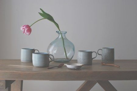 Speckled porcelain thrown mugs with tulip. Artist Helen Button