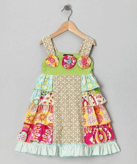 Cheerful ruffles that look like they're ready to dance trace the skirt of this essential dress. Whether a little one is toe tapping or leaping for joy, the snap straps and simple silhouette allow for the highest, silliest movements.