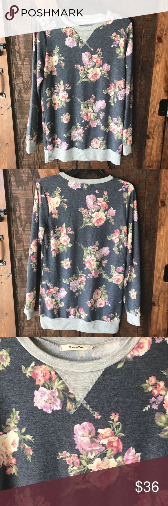 New Woman's French Terry Pullover Floral This is beautiful Woman's French Terry Floral Pullover. Brand new. Lightweight. 62% Polyester, 33% Rayon, 5% Spandex. So soft and warm. Looks adorable with jeans and boots. Small and large available. The Chic Petunia Tops Tees - Long Sleeve
