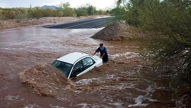 monsoon arizona flooded roads 2014 | ... the flooded road. (Photo/Sgt. Frausto, Quartzsite Police Department