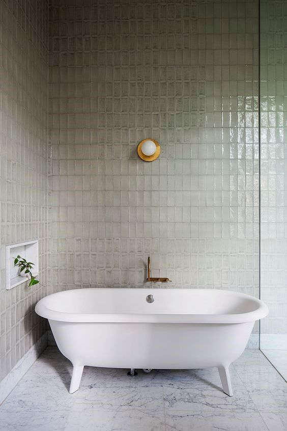 Freestanding Bath with protruding alcove and wall mounted tap