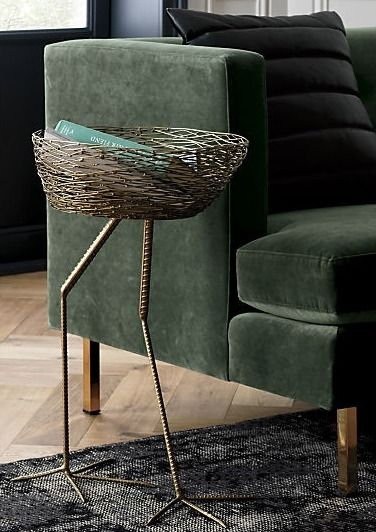 rare bird. Feather your nest with a surrealist side table for a song. Handcrafted by artisans, long-legged metal base supports a basket perfectly sized for mail, magazines or other nest materials.