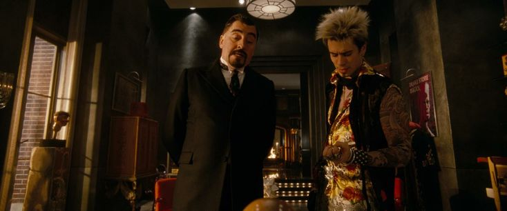 Alfred Molina as Maxim Horvath and Toby Kebbell as Drake Stone in Disney's The Sorcerer's Apprentice (2010).