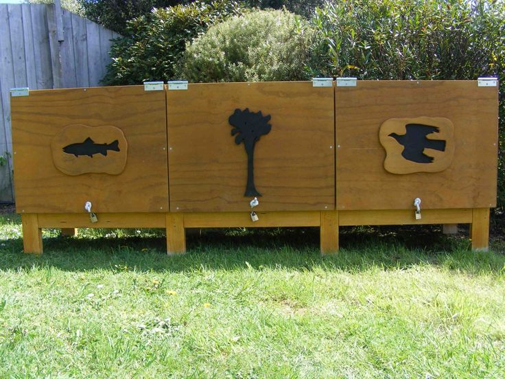 Sandpit storage box with three storage bays.