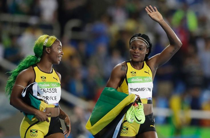 Jamaica's Elaine Thompson, right, celebrates winning the gold medal in the women's 100-meter final with third placed Jamaica's Shelly-Ann Fraser-Pryce during the athletics competitions in the Olympic stadium of the 2016 Summer  (1175×776)