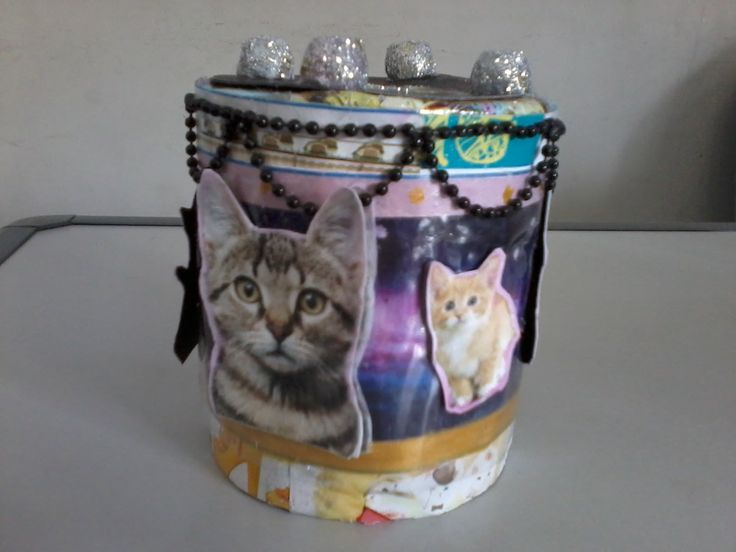 Intan's piggy bank/money box. It's made of can, animal paper cuttings, beads, glitter, and ribbon
