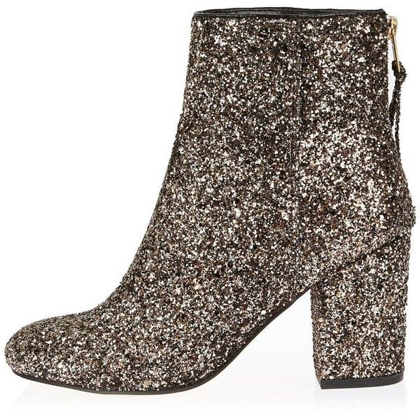 River Island Gold glitter block heel ankle boots (£66) ❤ liked on Polyvore featuring shoes, boots, ankle booties, yellow, ankle boots, block heel booties, glitter booties, gold boots and bootie boots