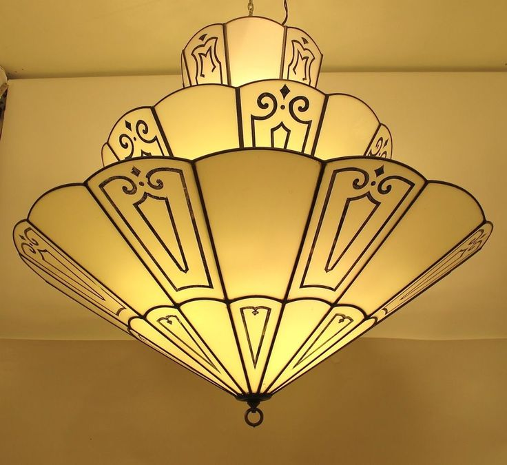 1920s-30s: Large Art Deco Theatre Light Fixture.    A very large Art Deco period ceiling light. Leaded opaque white glass with recessed and etched black design. The fixture holds 12 light bulbs.  This very light is shown in the book Extraordinary Interiors by Brian D. Coleman, pages 80/82.