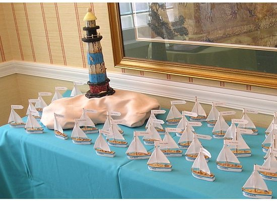 Table Of Beach Wedding Sailboat Escort Cards With Lighthouse