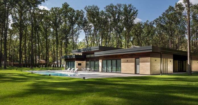 One-storey modern residence with clean and simple forms built on a huge plot in the forrest - CAANdesign | Architecture and home design blog
