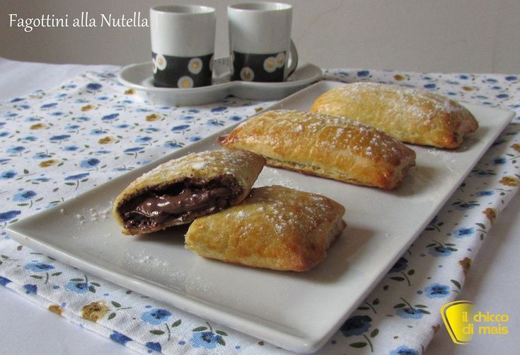 Fagottini alla nutella (ricetta con pasta sfoglia). Ricetta per dolci da colazione facili e veloci con pasta sfoglia ripiena di Nutella anche senza glutine