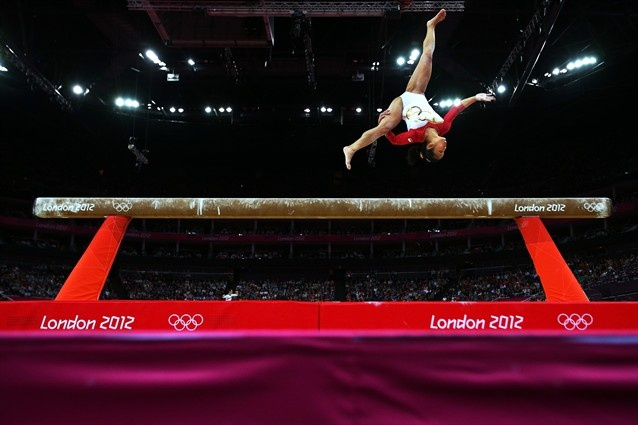 Gymnastics - Women's Qualifications - Gymnastics Slideshows | Heem Wei Lim of Singapore performs on the beam in the Artistic Gymnastics Women's Team qualification.  (Photo: Cameron Spencer / Getty Images) #NBCOlympics