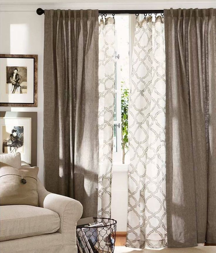 You could go for a layered look with your curtains - a heavier linen and then a patterned sheer fabric behind. It creates texture and would perfectly accompany the chevron rug if you get that.: