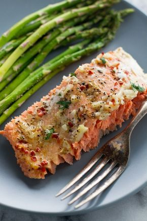 Lemon Garlic Butter Baked Salmon in Foil - 1¼ pound sockeye or coho salmon (preferably wild caught)* 2 tablespoons lemon juice 2 cloves garlic, minced 2 tablespoons cold butter, cubed ½ teaspoon salt ¼ teaspoon black pepper ¼ teaspoon Italian seasoning ¼ red pepper flakes 1 tablespoon chopped parsley, for garnishing (optional)
