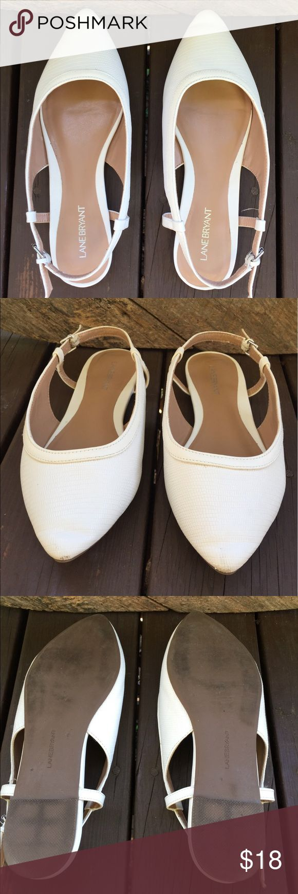 Lane Bryant white slip on shoes size 10W. Lane Bryant white slip on shoes size 10W. This is a great pair of wide dress shoes. They have adjustable straps on the back. They do show some minor scuffs to the toes but overall good shape. Please view all pictures. Lane Bryant Shoes Slippers